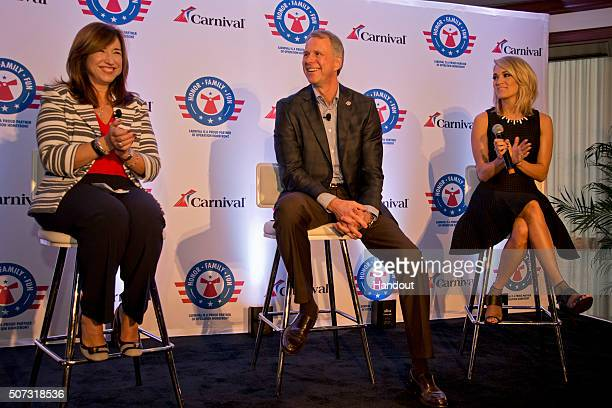 In this handout provided by Carnival Cruise Line Christine Duffy president of Carnival Cruise Line Brig Gen John Pray president and CEO of Operation...