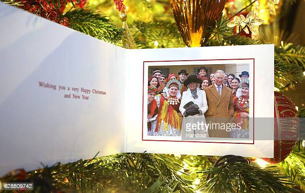 In this handout provided by Clarence House on December 10 shows The Prince of Wales and Duchess of Cornwall's 2016 Christmas card on a Christmas tree...