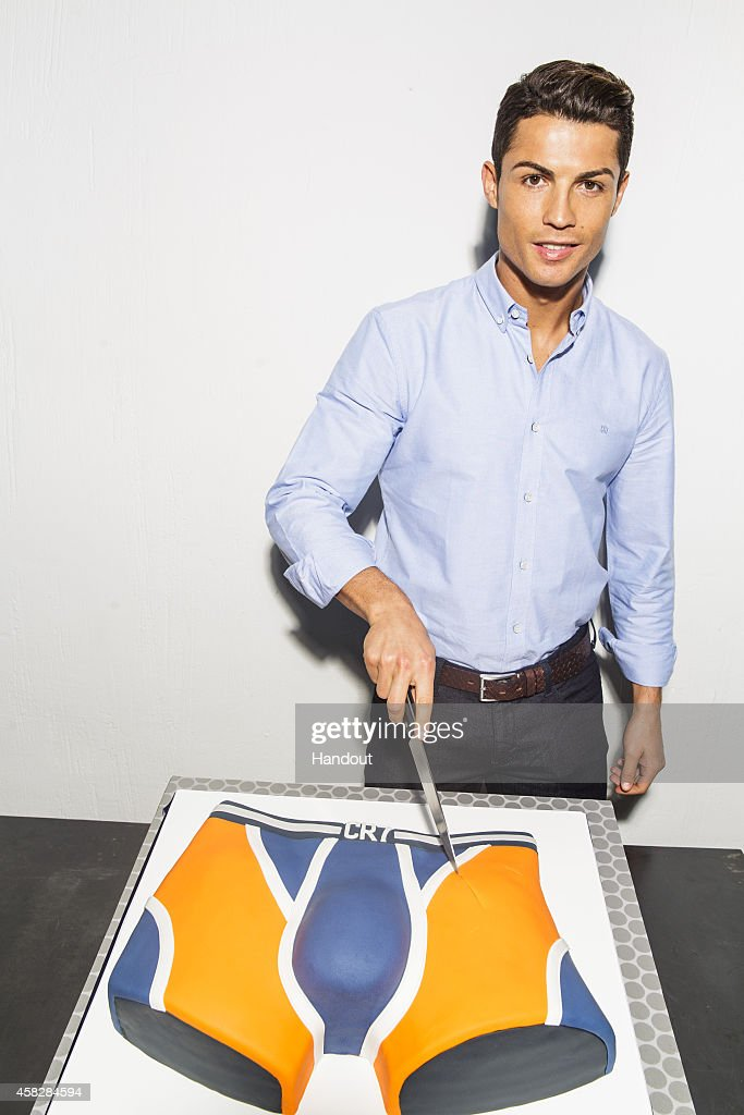 In this handout provided by CR7 on November 2, 2014, Cristiano Ronaldo cuts a cake to celebrate the first year anniversary of the global launch of the his CR7 Underwear brand in Madrid, Spain.