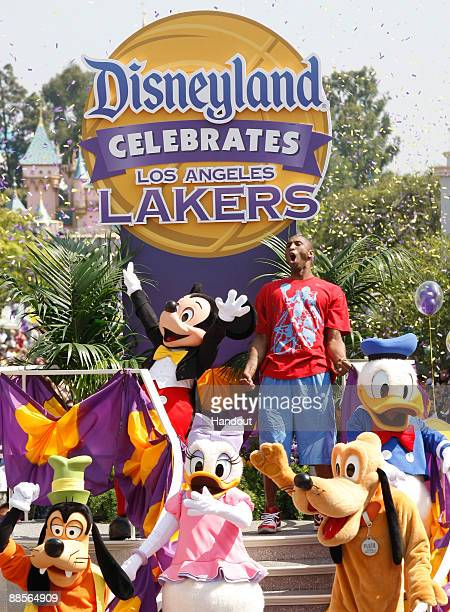 In this handout provided by Disney Lakers star and NBA Finals MVP Kobe Bryant waves to thousands of fans during a parade celebrating the 2009 World...