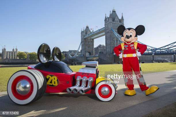 In this handout provided by Disney Mickey Mouse and his model Roadster Racer are spotted around London to celebrate the new series 'Mickey and the...