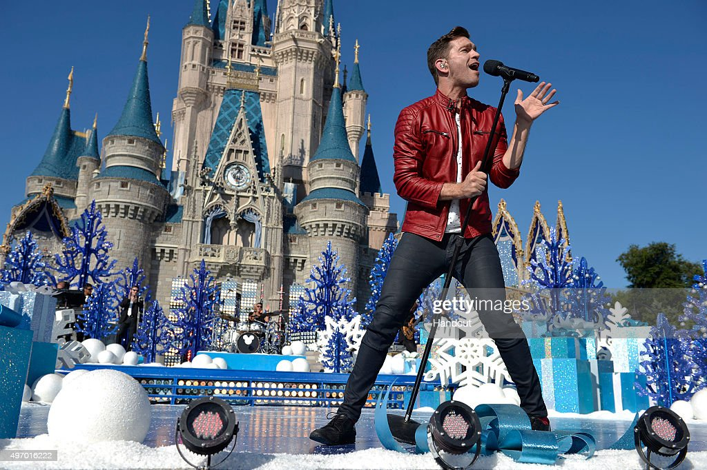 In this handout provided by Disney Parks, Andy Grammer performs during the taping of the 'Disney Parks Unforgettable Christmas Celebration' TV special in Magic Kingdom park at Walt Disney World Resort November 12, 2015 in Lake Buena Vista, Florida. The 32nd annual holiday telecast airs nationwide Dec. 25 at 10 a.m. ET and 9 a.m. CST, MST and PST on ABC-TV.