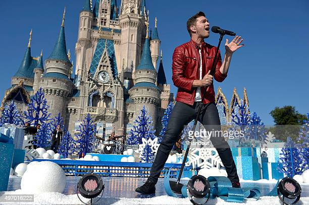 In this handout provided by Disney Parks Andy Grammer performs during the taping of the 'Disney Parks Unforgettable Christmas Celebration' TV special...