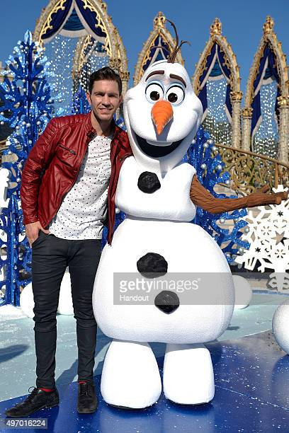 In this handout provided by Disney Parks Andy Grammer poses with Olaf from Disneys Frozen during a break from taping the 'Disney Parks Unforgettable...