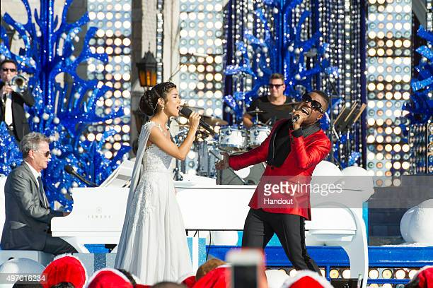In this handout provided by Disney Parks Charles Perry and Jhené Aiko perform during the taping of the 'Disney Parks Unforgettable Christmas...