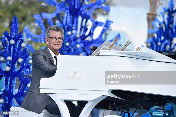 In this handout provided by Disney Parks David Foster performs during the taping of the 'Disney Parks Unforgettable Christmas Celebration' TV special...