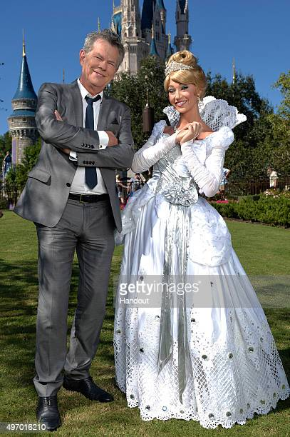 In this handout provided by Disney Parks David Foster poses with Cinderella during a break from taping the 'Disney Parks Unforgettable Christmas...