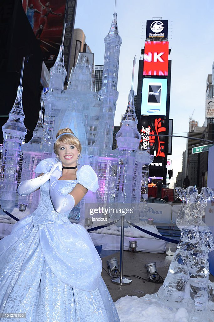In this handout provided by Disney Parks, Disney Princess Cinderella poses in front of a 25-foot-tall ice castle sculpture in Times Square October 17, 2012 in New York City. Disney Parks unveiled a 25-foot-tall, 45,000-pound castle made of ice as the sun rose Oct, 17, 2012 over Times Square in New York City. The icy structure was unveiled during the Disney Parks announcement of 'Limited Time Magic' that will take place throughout 2013 at Disneyland Resort in California and Walt Disney World Resort in Florida. Next year, each week at the Disney theme parks will be highlighted by a different surprise or guest enhancement for a one-week-only engagement. Each weekly surprise, many never-before-seen in the Disney Parks, will include entertainment, dining, character experiences and more. Each one will disappear after seven days and make way for the next week's Limited Time Magic experience. Combined with the heat of the morning and early-afternoon sun, the ice castle in Times Square -- which took more than 12 hours to construct and craft -- demonstrates the short-lived nature of Disney's Limited Time Magic.