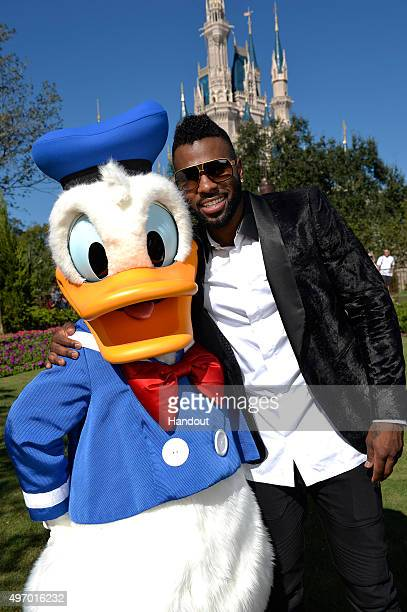 In this handout provided by Disney Parks Jason Derulo poses with Donald Duck during a break from taping the 'Disney Parks Unforgettable Christmas...