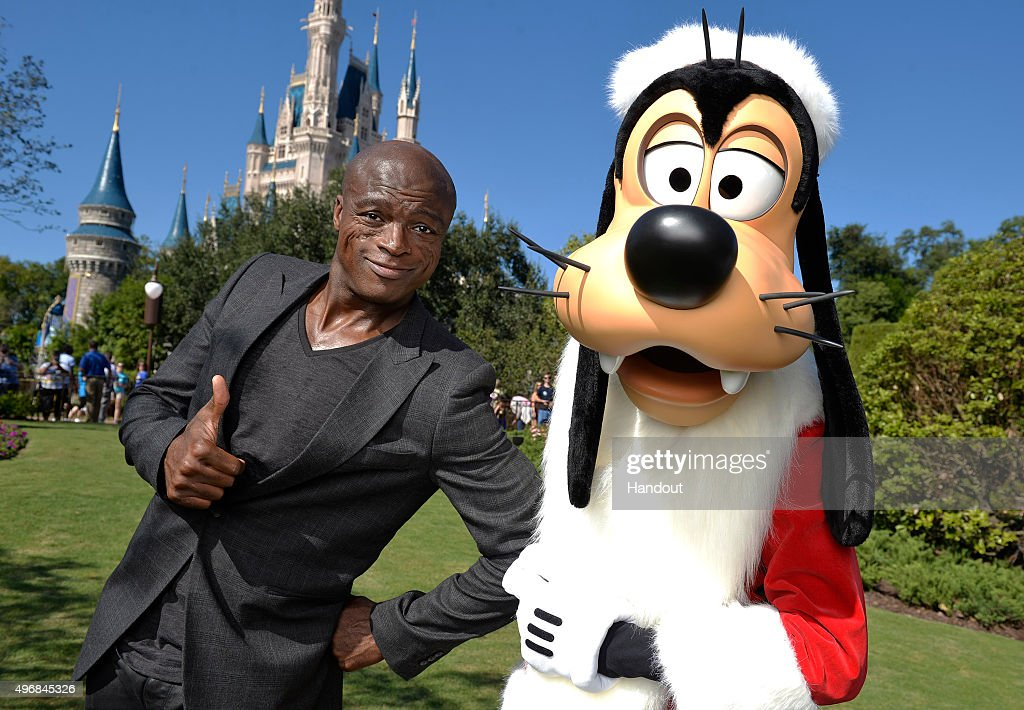 In this handout provided by Disney Parks, Seal poses with Santa Goofy during a break from taping the 'Disney Parks Unforgettable Christmas Celebration' TV special in Magic Kingdom park at Walt Disney World Resort November 11, 2015 in Lake Buena Vista, Florida. The 32nd annual holiday telecast airs nationwide Dec. 25 at 10 a.m. ET and 9 a.m. CST, MST and PST on ABC-TV.