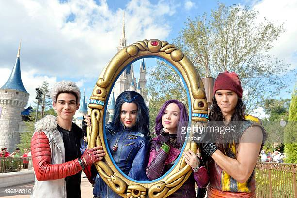 In this handout provided by Disney Parks The cast of Disney Channel Original Movie 'Descendants' Cameron Boyce who plays Carlos Sofia Carson who...