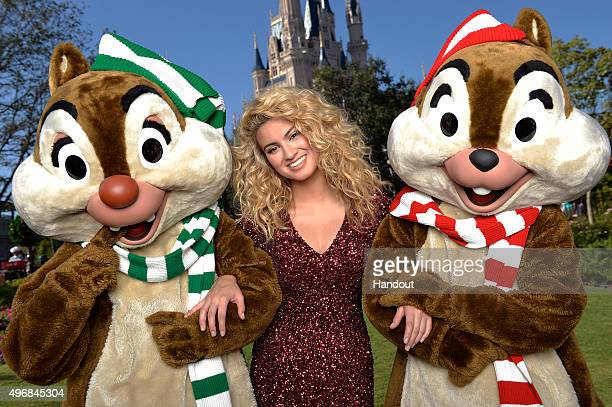 In this handout provided by Disney Parks Tori Kelly performs during the taping of the 'Disney Parks Unforgettable Christmas Celebration' TV special...