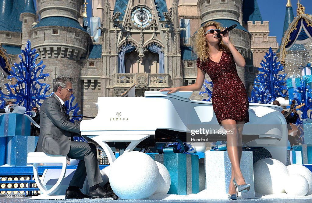 In this handout provided by Disney Parks, Tori Kelly performs during the taping of the 'Disney Parks Unforgettable Christmas Celebration' TV special in Magic Kingdom park at Walt Disney World Resort November 11, 2015 in Lake Buena Vista, Florida. The 32nd annual holiday telecast airs nationwide Dec. 25 at 10 a.m. ET and 9 a.m. CST, MST and PST on ABC-TV.