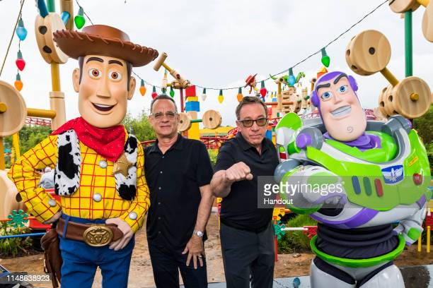 In this Handout provided by Disney Resorts Stars from DisneyPixars Toy Story 4 Woody Tom Hanks Tim Allen and Buzz Lightyear appear with characters...