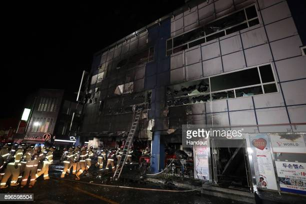 In this handout provided by Donga Daily Firefighters make their way into a building on December 21 2017 in Jecheon South Korea The death toll jumped...