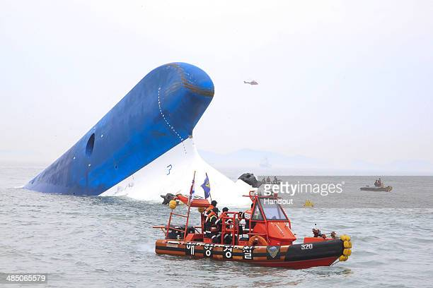 In this handout provided by Donga Daily The Republic of Korea Coast Guard work at the site of ferry sinking accident off the coast of Jindo Island on...