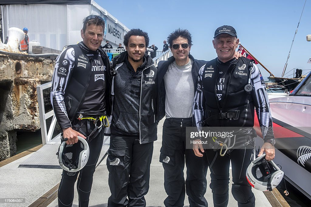 In this handout provided by Emirates, (L-R) Emirates Team New Zealand Skipper Dean Barker, Connor Cruise, Tom Cruise and Emirates Team New Zealand Managing Director Grant Dalton pose for a photo after Tom Cruise went for a ride on NZL5 after the Louis Vuitton Cup Round Robin 5 race against Team Luna Rossa Challenge on July 28, 2013 in San Francisco, California.