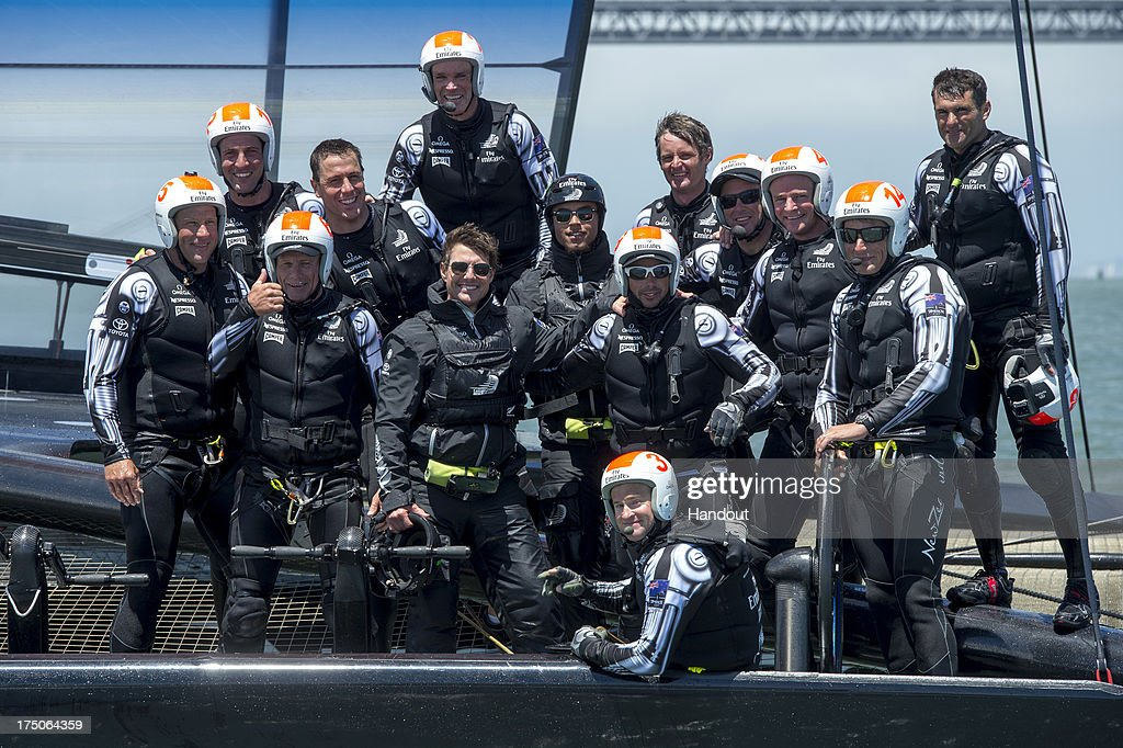 In this handout provided by Emirates, Emirates Team New Zealand takes Tom Cruise for a ride on NZL5 after the Louis Vuitton Cup Round Robin 5 race against Team Luna Rossa Challenge on July 28, 2013 in San Francisco, California.