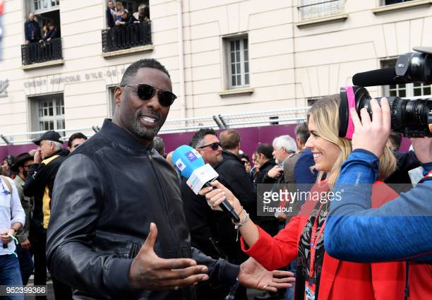 In this handout provided by FIA Formula E Actor Idris Elba talking to TV Presenter Nicki Shields during the Paris EPrix in the Paris ePrix Round 8 of...