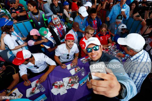 In this handout provided by FIA Formula E Daniel Abt Audi Sport ABT Schaeffler Audi etron FE04 poses for an selfie with a fan during the Mexico City...