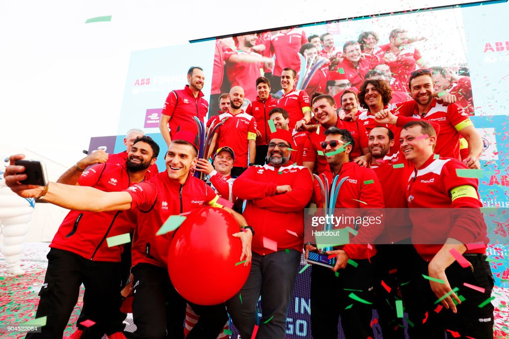In this handout provided by FIA Formula E - Felix Rosenqvist (SWE), Mahindra Racing, Mahindra M4Electro, and Dilbagh Gill, CEO and Team Principal, Mahindra Racing, celebrate with the rest of the team during the Marrakech ePrix, Round 3 of the 2017/18 FIA Formula E Series at the Circuit International Automobile Moulay El Hassan on January 13, 2018 in Marrakech, Morocco.