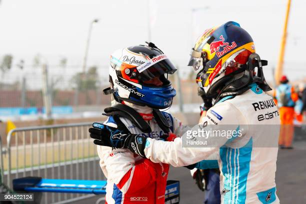 In this handout provided by FIA Formula E Felix Rosenqvist Mahindra Racing Mahindra M4Electro celebrates with Sebastien Buemi Renault eDams Renault...