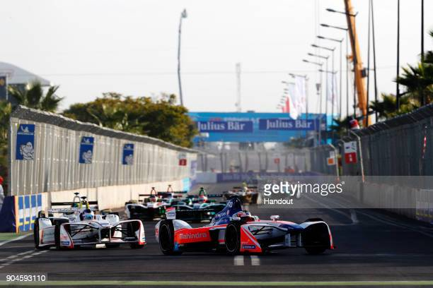 In this handout provided by FIA Formula E Felix Rosenqvist Mahindra Racing Mahindra M4Electro and Jose Maria Lopez Dragon Penske EV2 in action during...