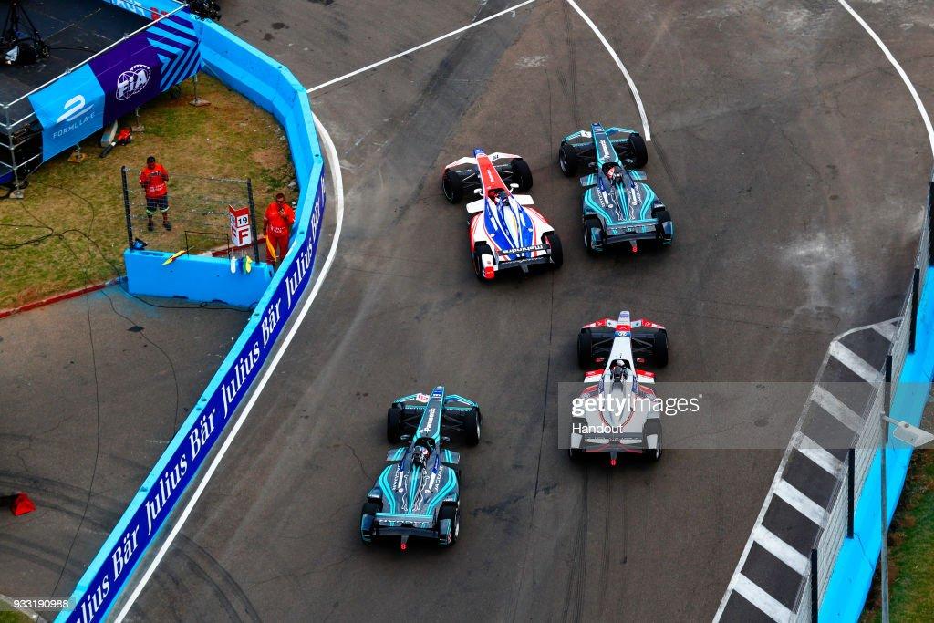 In this handout provided by FIA Formula E, Felix Rosenqvist (SWE), Mahindra Racing, Mahindra M4Electro, Nelson Piquet Jr (BRA), Panasonic Jaguar Racing, Jaguar I-Type II,Mitch Evans (NZL), Panasonic Jaguar Racing, Jaguar I-Type II, and Maro Engel (GER), Venturi Formula E, Venturi VM200-FE-03 during the Punta del Este ePrix, Round 6 of the 2017/18 FIA Formula E Series on March 17, 2018 at Playa Brava Beach in Punta del Este, Uruguay.