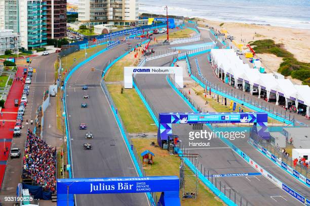 In this handout provided by FIA Formula E JeanEric Vergne TECHEETAH Renault ZE 17 leadsLucas Di Grassi Audi Sport ABT Schaeffler Audi etron FE04 and...