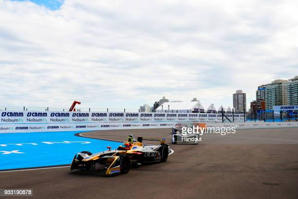 In this handout provided by FIA Formula E JeanEric Vergne TECHEETAH Renault ZE 17 leads Lucas Di Grassi Audi Sport ABT Schaeffler Audi etron FE04...