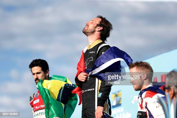 In this handout provided by FIA Formula E JeanEric Vergne TECHEETAH Renault ZE 17 celebrates on the podium with Lucas Di Grassi Audi Sport ABT...