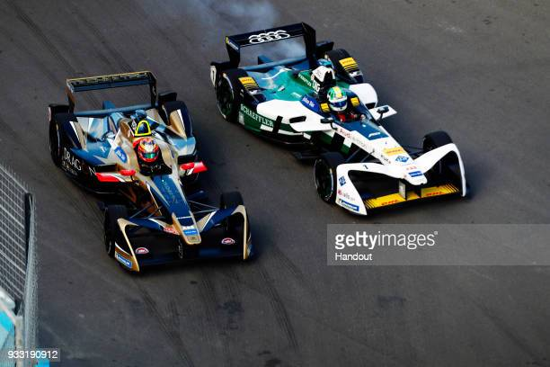 In this handout provided by FIA Formula E JeanEric Vergne TECHEETAH Renault ZE 17 battles with Lucas Di Grassi Audi Sport ABT Schaeffler Audi etron...