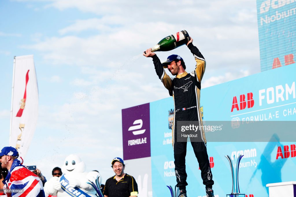 In this handout provided by FIA Formula E, Jean-Eric Vergne (FRA), TECHEETAH, Renault ZE 17, sprays the champagne on the podium during the Punta del Este ePrix, Round 6 of the 2017/18 FIA Formula E Series on March 17, 2018 at Playa Brava Beach in Punta del Este, Uruguay.