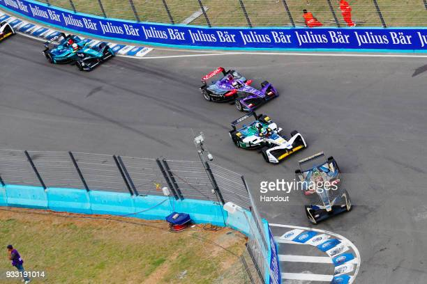 In this handout provided by FIA Formula E JeanEric Vergne TECHEETAH Renault ZE 17 leads Lucas Di Grassi Audi Sport ABT Schaeffler Audi etron FE04 and...