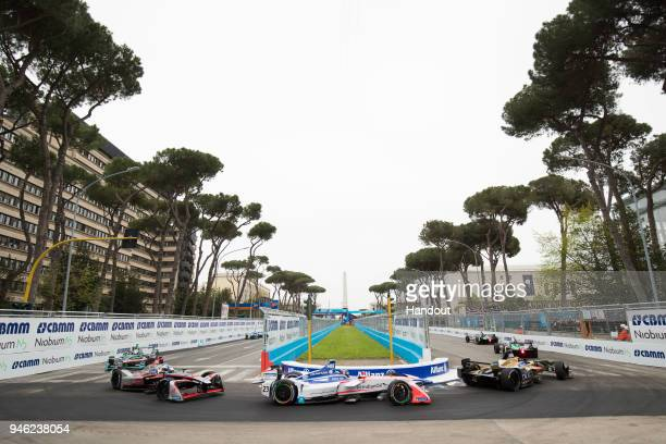 In this handout provided by FIA Formula E, Jean-Eric Vergne , TECHEETAH, Renault Z.E. 17, leads Nick Heidfeld , Mahindra Racing, Mahindra M4Electro...