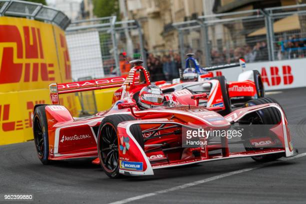 In this handout provided by FIA Formula E, Jrme d'Ambrosio , Dragon Racing, Penske EV-2, leads Nick Heidfeld , Mahindra Racing, Mahindra M4Electro....