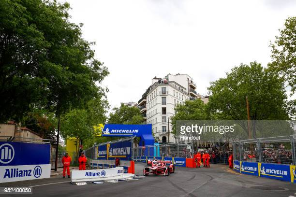In this handout provided by FIA Formula E, Jrme d'Ambrosio , Dragon Racing, Penske EV-2, Nick Heidfeld , Mahindra Racing, Mahindra M4Electro. During...