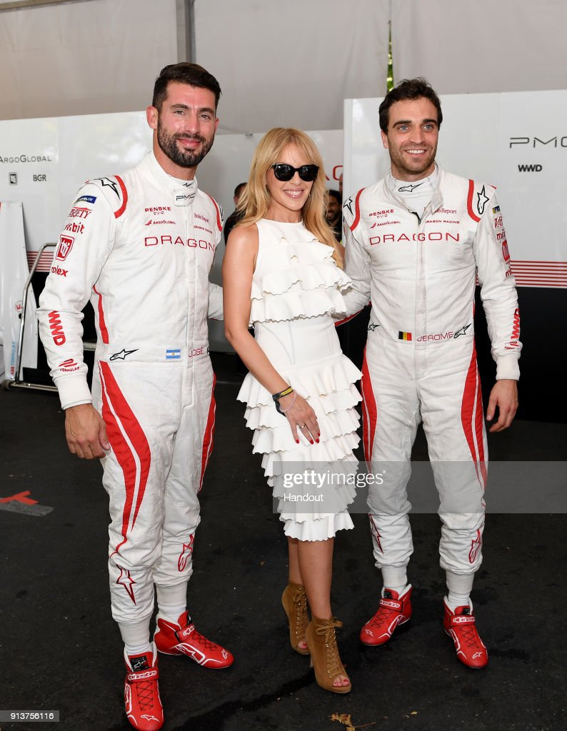 In this handout provided by FIA Formula E, Kylie Minogue with race drivers Jose Maria Lopez (ARG), Dragon, Penske EV-2, and Jérôme d'Ambrosio (BEL), Dragon Racing, Penske EV-2 during the Santiago ePrix, Round 4 of the 2017/18 FIA Formula E Series on February 3, 2018 in Santiago, Chile.