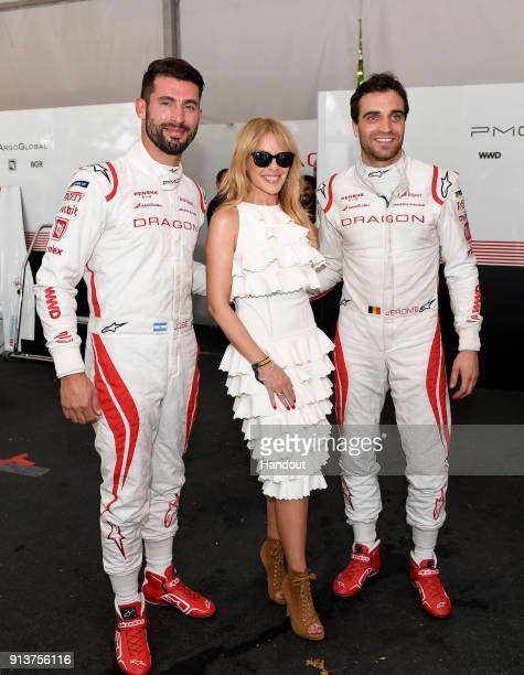 In this handout provided by FIA Formula E Kylie Minogue with race drivers Jose Maria Lopez Dragon Penske EV2 and Jérôme d'Ambrosio Dragon Racing...