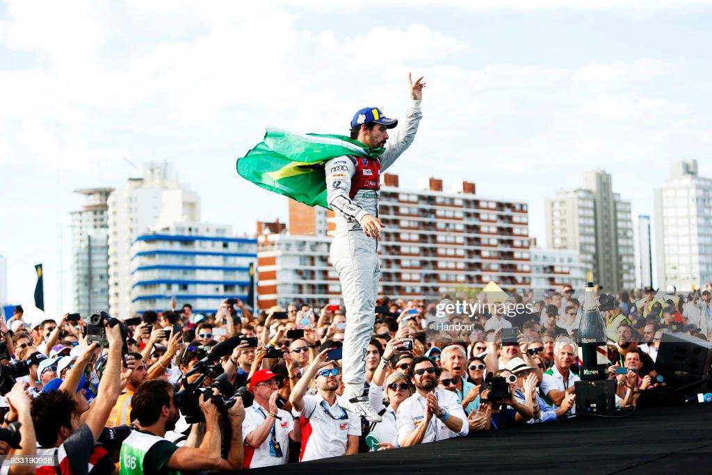 In this handout provided by FIA Formula E, Lucas Di Grassi (BRA), Audi Sport ABT Schaeffler, Audi e-tron FE04, celebrates on the podium during the Punta del Este ePrix, Round 6 of the 2017/18 FIA Formula E Series on March 17, 2018 at Playa Brava Beach in Punta del Este, Uruguay.