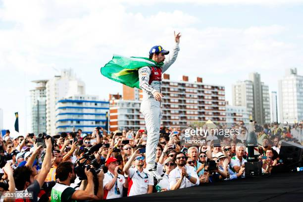 In this handout provided by FIA Formula E Lucas Di Grassi Audi Sport ABT Schaeffler Audi etron FE04 celebrates on the podium during the Punta del...
