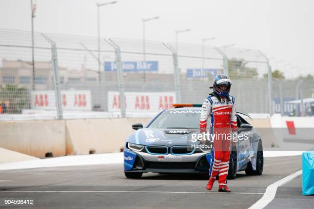 In this handout provided by FIA Formula E Nick Heidfeld Mahindra Racing Mahindra M4Electro with the Qualcomm BMW Safety Car in action during the...