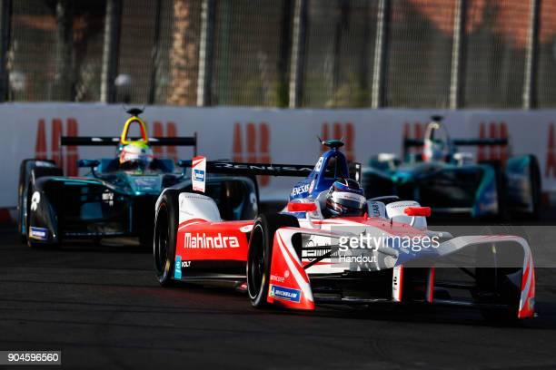 In this handout provided by FIA Formula E Nick Heidfeld Mahindra Racing Mahindra M4Electro and Oliver Turvey NIO Formula E Team NextEV NIO Sport 003...
