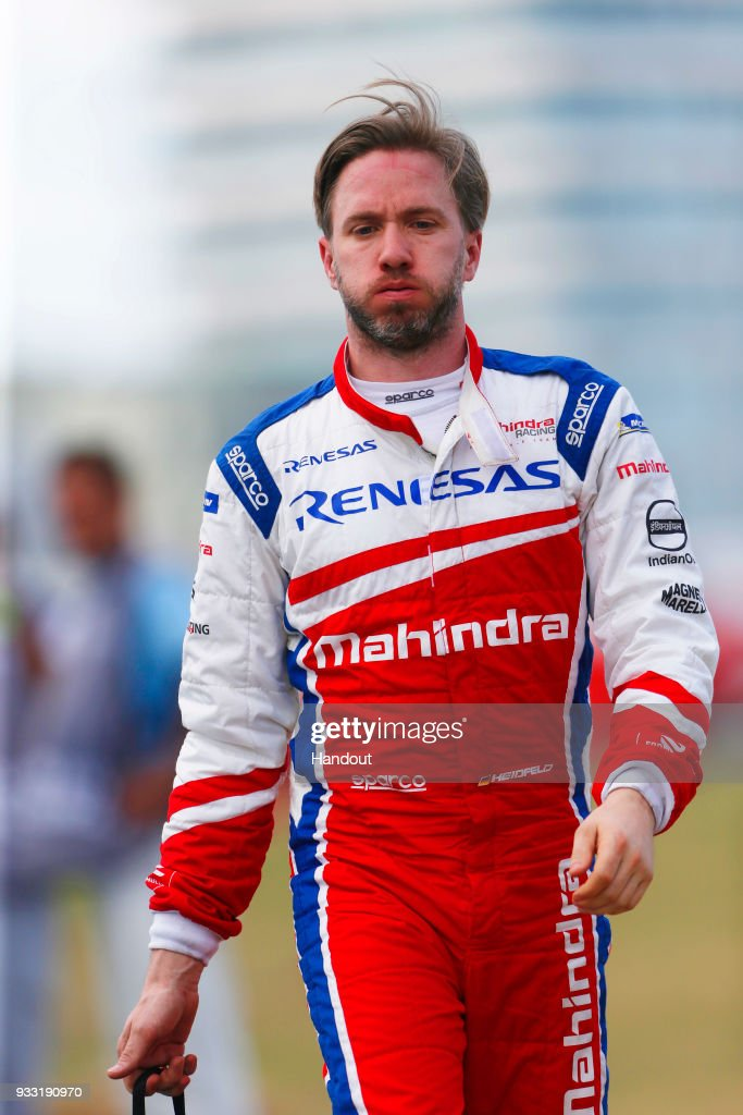 In this handout provided by FIA Formula E, Nick Heidfeld (GER), Mahindra Racing, Mahindra M4Electro, walks back to the pits after retiring from the race during the Punta del Este ePrix, Round 6 of the 2017/18 FIA Formula E Series on March 17, 2018 at Playa Brava Beach in Punta del Este, Uruguay.