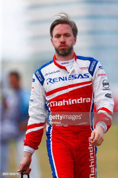 In this handout provided by FIA Formula E, Nick Heidfeld , Mahindra Racing, Mahindra M4Electro, walks back to the pits after retiring from the race...