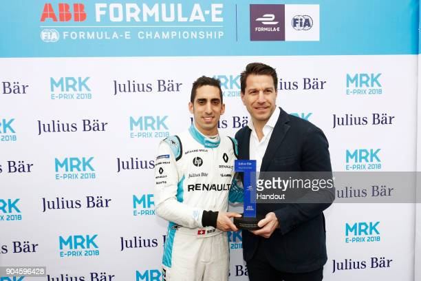 In this handout provided by FIA Formula E Sebastien Buemi Renault eDams Renault ZE 17 receives the Julius Bar pole position award during the...