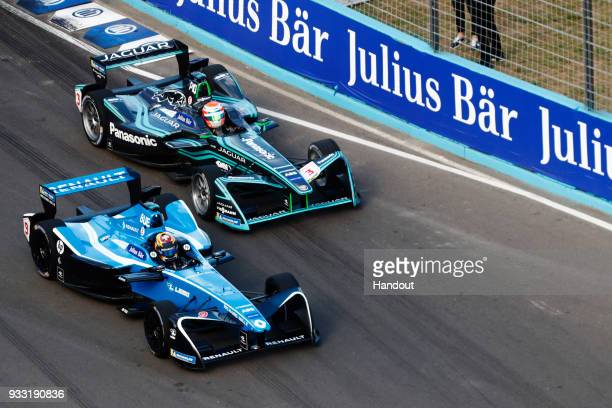 In this handout provided by FIA Formula E Sebastien Buemi Renault eDams Renault ZE 17 and Nelson Piquet Jr Panasonic Jaguar Racing Jaguar IType II...