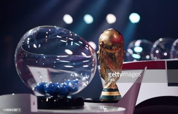 In this handout provided by FIFA, the World Cup Trophy and the draw pot are seen during the Preliminary Draw of the 2022 Qatar FIFA World Cup on...