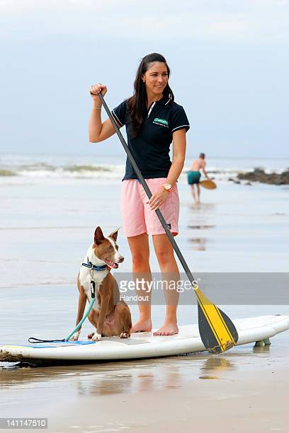 In this handout provided by Friends Furever The Advantage Family A Team member Giaan Rooney is seen during the Surfing Dog Spectacular on March 12...
