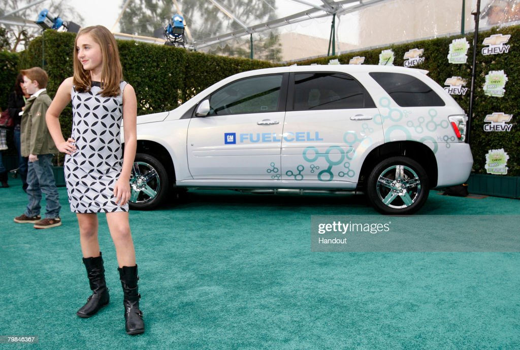 In this handout provided by General Motors, Actress Rachel Fox stops for photographers on the green carpet near the Chevrolet Equinox Fuel Cell upon her arrival at Chevy Rocks the Future, an entertainment and education event designed to inspire Los Angeles-area school children to protect the environment at The Walt Disney Studios on February 19, 2008 in Burbank, California.
